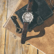 Man wristwatch, calendar, key and glasses on a old table. — Stock Photo