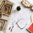 Overhead of building model and drafting tools on a construction plan. — Stock Photo #41265769