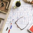 Overhead of building model and drafting tools on a construction plan. — Stock Photo #41265847
