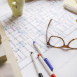 Closeup of building model and drafting tools on a construction plan. — Stock Photo #41265901