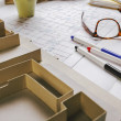 Closeup of building model and drafting tools on a construction plan. — Stock Photo #41265947