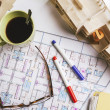 Overhead of building model and drafting tools on a construction plan. — Stock Photo #41266013
