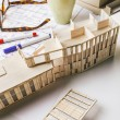 Closeup of building model and drafting tools on a construction plan. — Stock Photo #41266019