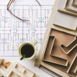Overhead of building model and drafting tools on a construction plan. — Stock Photo #41266045