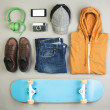 Stock Photo: Outfit of skater mon grey background.
