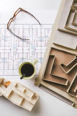Overhead of building model and drafting tools on a construction plan. — Stock Photo