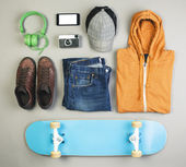 Outfit of skater man on grey background. — Stock Photo