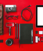 Closeup of different photography objects on red background.  — Stock Photo