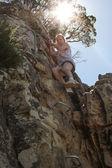 Donna salendo a testa di Leone — Foto Stock