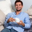 Young man enjoying a coffeebreak — Stock Photo