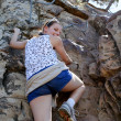Stock Photo: WomClimbing Up Lions Head