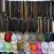 Постер, плакат: Belts and hats for sale