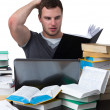 Young Student overwhelmed with studying — Stock Photo #13827414