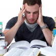 Young Student overwhelmed with studying — 图库照片