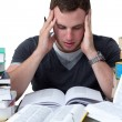Stock Photo: Young Student overwhelmed with studying