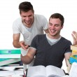 Photo: Two young men studying together