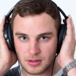 Close Up of Face of young man listening to music — Stock Photo