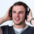 Close Up of Face of young man listening to music - Stock Photo