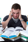 Young Student overwhelmed with studying — Stok fotoğraf