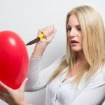 Woman destroying heart — Stock Photo