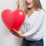 Woman destroying heart after breakup — Stock Photo