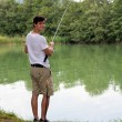 Man Fishing at a lake — Stock Photo