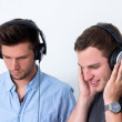 Two friends listening to music — Stock Photo #17375461
