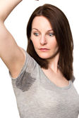 Woman sweating very badly under armpit — Stock Photo