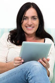 Black haired woman using a Table PC — Stock Photo