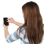 Brunette Girl using a Smartphone — Stock Photo