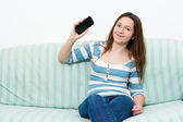 Brunette Girl using a Smartphone — Stockfoto
