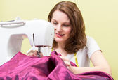 Brunette woman sewing — Stock Photo