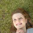 Young happy woman in grass — Stock Photo