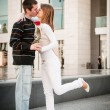 Young man handing over a flower to woman — Stock Photo #18169023