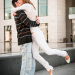 Young man welcomes his girlfriend — Stock Photo #18169031