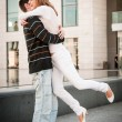 Young man welcomes his girlfriend — Stock Photo