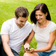 Stock Photo: Young couple with smartphone