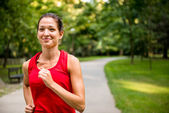 Young woman jogging in park — Stock Photo