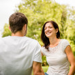 Young couple talking outdoor — Stock Photo