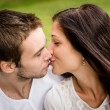 Young kissing couple in love — Stock Photo