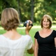 Stock Photo: Woman is taking video of her mother
