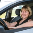 Portrait of senior woman in car — Stock Photo