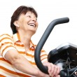 Spinning mature woman — Stock Photo