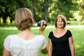 Woman is taking video of her mother — Stock Photo