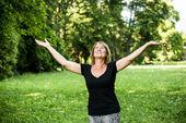 Happy senior woman in nature — Stock Photo