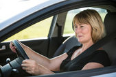 Senior woman driving car — Stock Photo