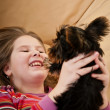Portrait of child playing with dog — Stock Photo