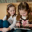 Children playing with tablet — Stock Photo