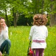 Stock Photo: Nostalgy - mother with her child outdoors