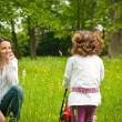 Nostalgy - mother with her child outdoors - Stock Photo
